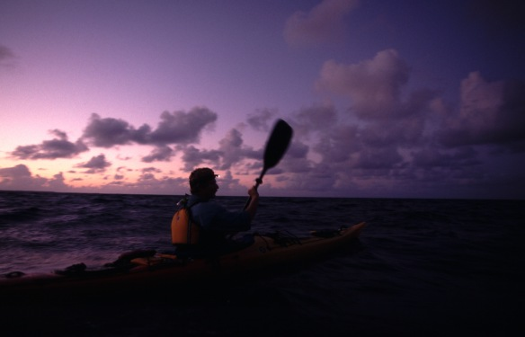 Willie in kayak night crossing-Peter McBride photo